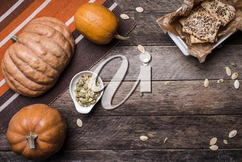 pumpkins with cookies and seeds on wooden table . Autumn Season food photo