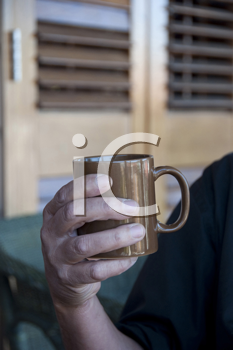 Royalty Free Photo of a Person Holding a Mug