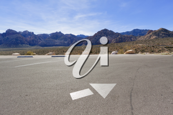 Directional arrow on the empty parking lot in Mojave Desert, Nevada.