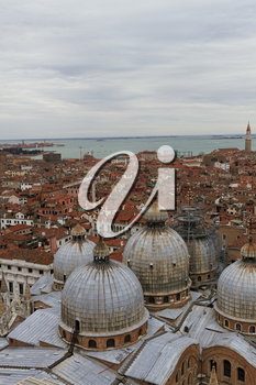 Rooftop views of canals and ancient architecture in Venice, Italy. Venice is a city in northeastern Italy sited on a group of 118 small islands separated by canals and linked by bridges.