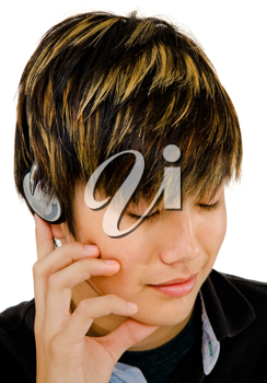 Royalty Free Photo of a Teenage Boy Listening to Music on Headphones