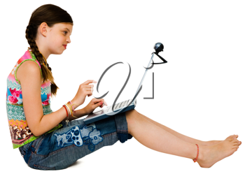 Confident girl using a laptop and smiling isolated over white