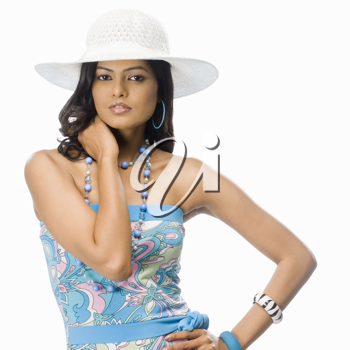Portrait of a female fashion model posing against white background