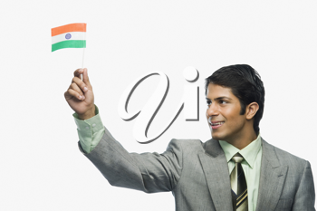 Close-up of a man holding an Indian flag