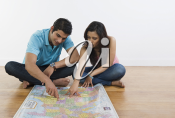 Couple examining a map