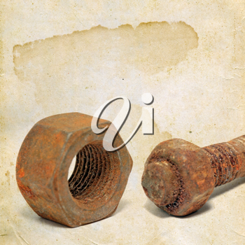 rusty bolt and nut on grunge background