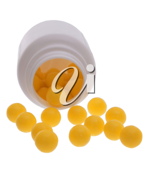 Vitamins scattered on a white background.