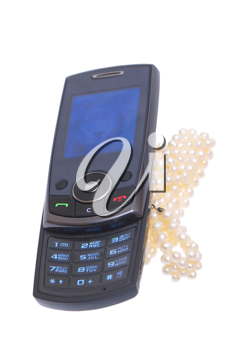 Mobile phone with pearls on a white background.