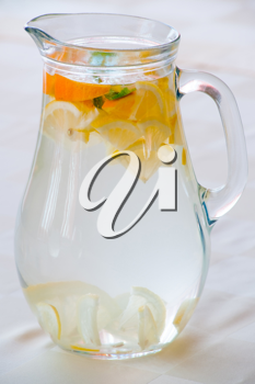 Royalty Free Photo of a Jug of Water With Sliced Fruit