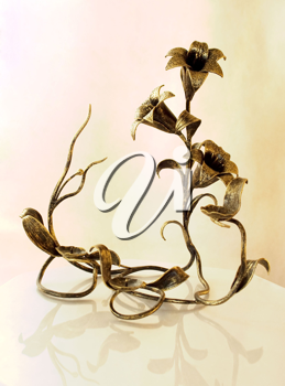 Candlestick in the form of lilies on a white background