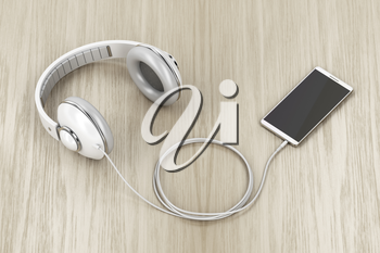 Big wired headphones and smartphone with blank display on wood table