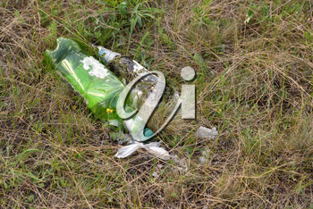 Abandoned plastic and glass bottle on nature, pollution of nature.