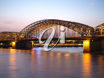 Hohenzollernbruecke (meaning Hohenzollern Bridge) crossing the river Rhein in Koeln, Germany