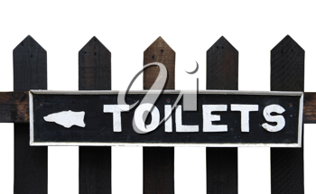 Royalty Free Photo of a Vintage Toilet Sign on a Wooden Fence