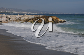 Royalty Free Photo of a Beach With a Stone Pier in Puerto Banus Marbella, Spain