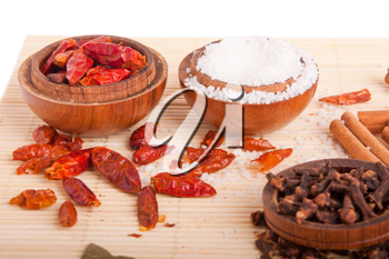 Royalty Free Photo of Piri Piri and Salt in Wooden Bowls