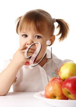 Royalty Free Photo of a Girl Eating an Apple