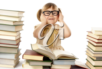 Royalty Free Photo of a Little Girl With Glasses and Lots of Books
