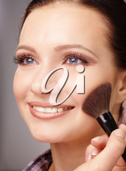 Royalty Free Photo of a Woman Having Blush Applied