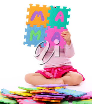 Royalty Free Photo of a Little Girl With Foam Letters Spelling Mama