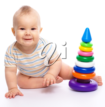 Royalty Free Photo of a Child Playing With a Toy