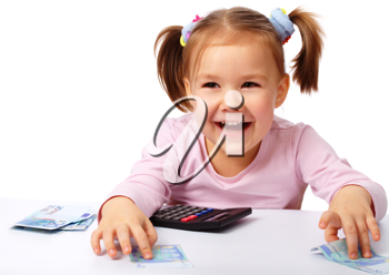 Royalty Free Photo of a Little Girl With Money and a Calculator