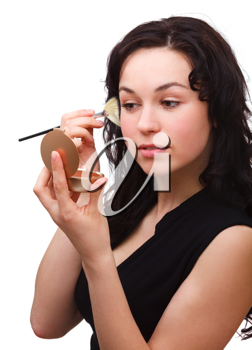 Royalty Free Photo of a Young Woman Applying Makeup