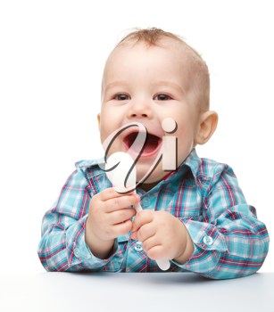 Royalty Free Photo of a Little Boy Holding a Spoon