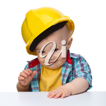Royalty Free Photo of a Boy Wearing a Hardhat