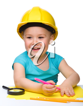 Royalty Free Photo of a Little Girl Wearing a Hard Hat