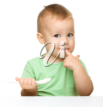 Royalty Free Photo of a Little Boy With a Spoon