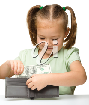 Royalty Free Photo of a Little Girl Putting Money in a Wallet
