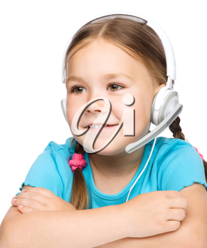 Cute young girl is working as an operator at helpline talking with customer using headset, isolated over white