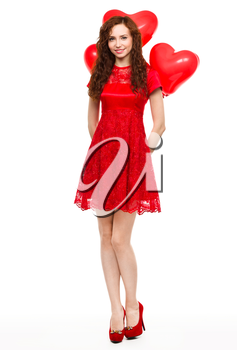Young woman holding heart-shaped balloons, Valentine day concept, isolated over white