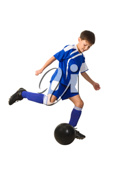 Royalty Free Photo of a Boy Playing Football