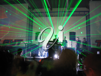 Royalty Free Photo of a DJ and Green Laser