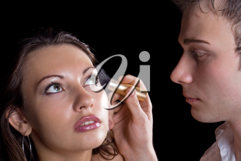 Royalty Free Photo of a Man Applying a Woman's Makeup
