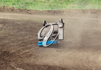 Royalty Free Photo of a Flipped Car