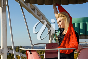 Royalty Free Photo of a Woman on a Ferris Wheel