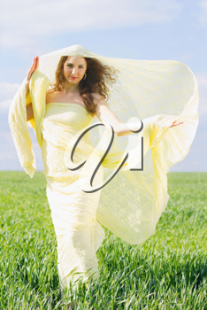 Young smiling woman wrapped in yellow cloth