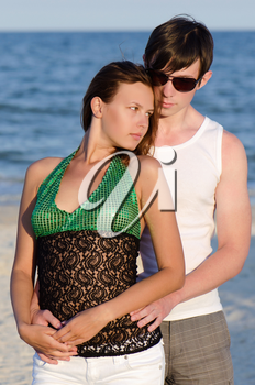 Portrait of a beautiful young couple on the beach