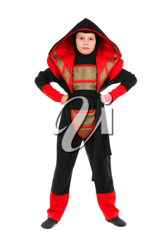 Little boy wearing red and black ninja costume. Isolated on white