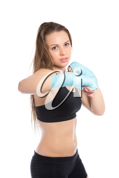 Young blond woman posing in blue bandages. Isolated on white