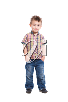 Handsome little boy posing in casual clothes. Isolated on white