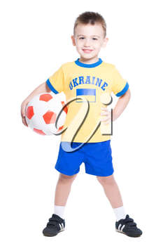 Nice little Ukrainian football player posing with a ball. Isolated on white