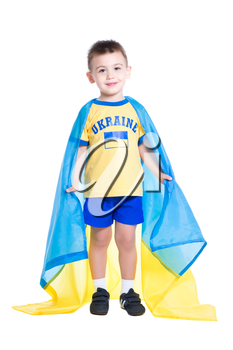 Nice little Ukrainian boy wrapped in the flag of his country. Isolated on white