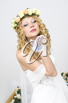 Royalty Free Photo of a Bride Blowing a Kiss