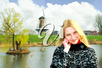 Girl on the waterfront in the Dutch town of Gorinchem. Netherlands