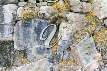 Royalty Free Photo of a Cracked Stone Wall