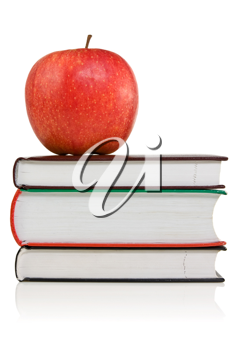 Royalty Free Photo of an Apple on a Stack of Books